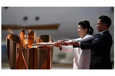 The ancient olympic champions Saori Yoshida and Tadahiro Nomura lit the cauldron at the Games of Tokyo with the olympic flame after getting off the plane that brought her to Greece, on the 20th of march 2020 in the base area of Higashimatsushima (Japan)