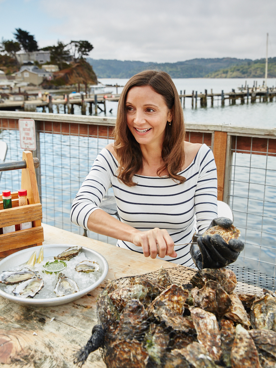 Annette White shucking Raw Oysters in Tomales