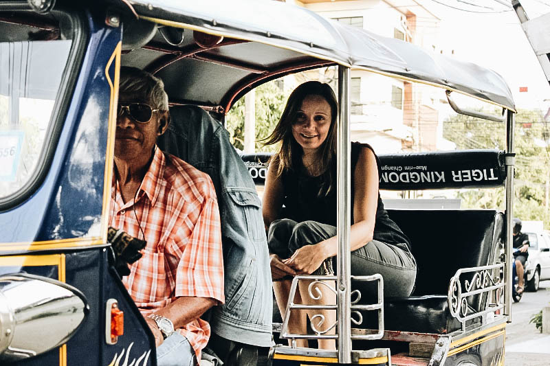 Annette White Riding in a Tuk Tuk in Thailand