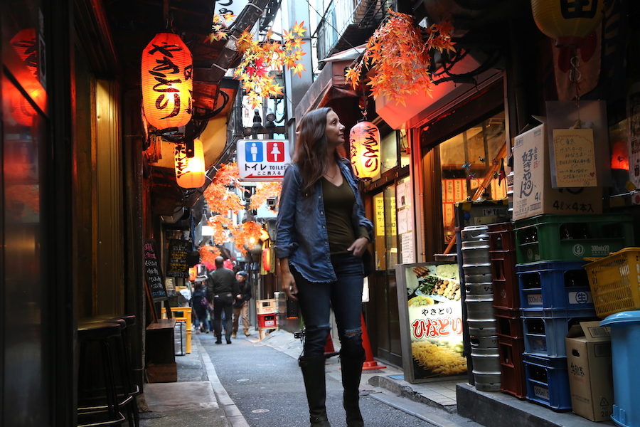 Annette White walking through Tokyo's Piss Alley