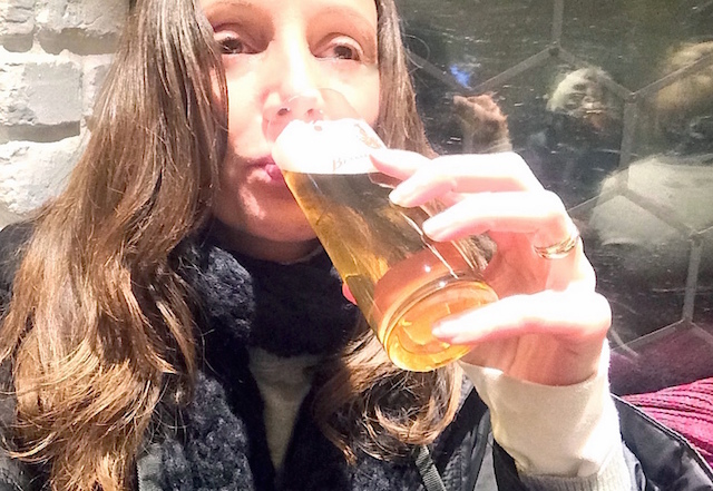 Annette White drinking Kolsch Beer at a Brauhaus in Cologne