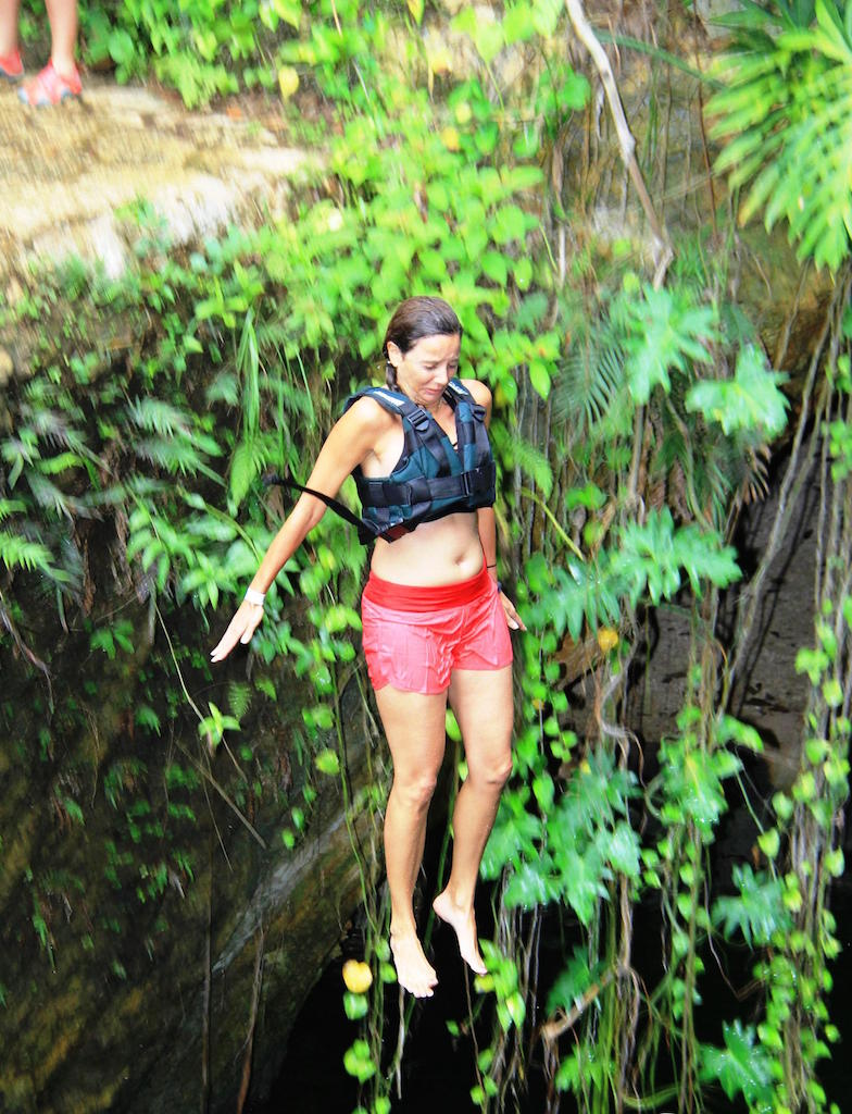Annette White Cliff Jumping into a Cenote in Cancun, Mexico