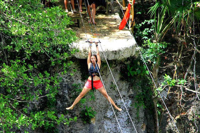 Annette White Ziplining over a Cenote in Mexico