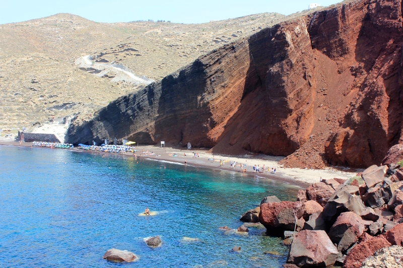 Swim at the Red Sand Beach | Santorini Bucket List: Best Things to do & Attractions to See
