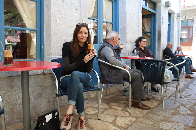 Annette White Drinking a Frappe in Lidoriki Village in Central Greece
