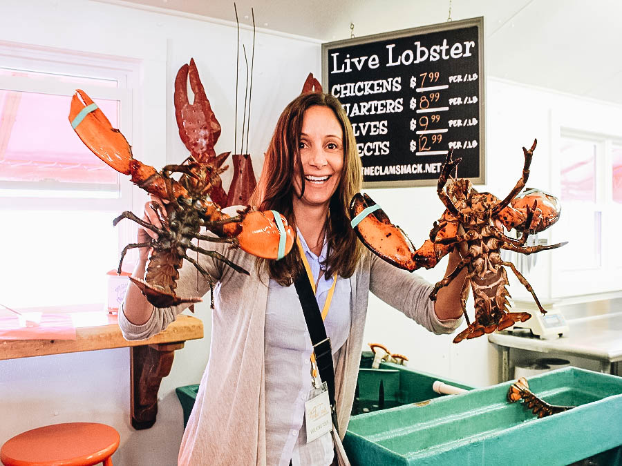 Annette holding two lobsters