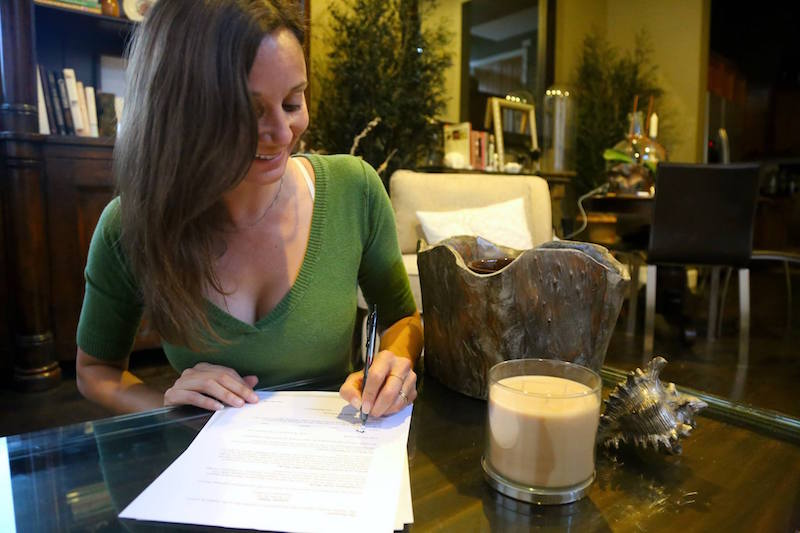 Annette White signing the Book Contract