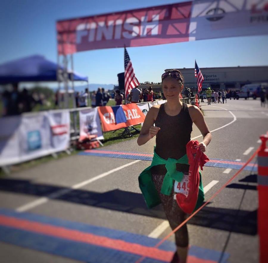 Annette White crossing the finish line at the San Francisco Golden Gate 5k Run