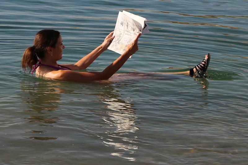 Annette White floating in The Dead Sea in Jordan