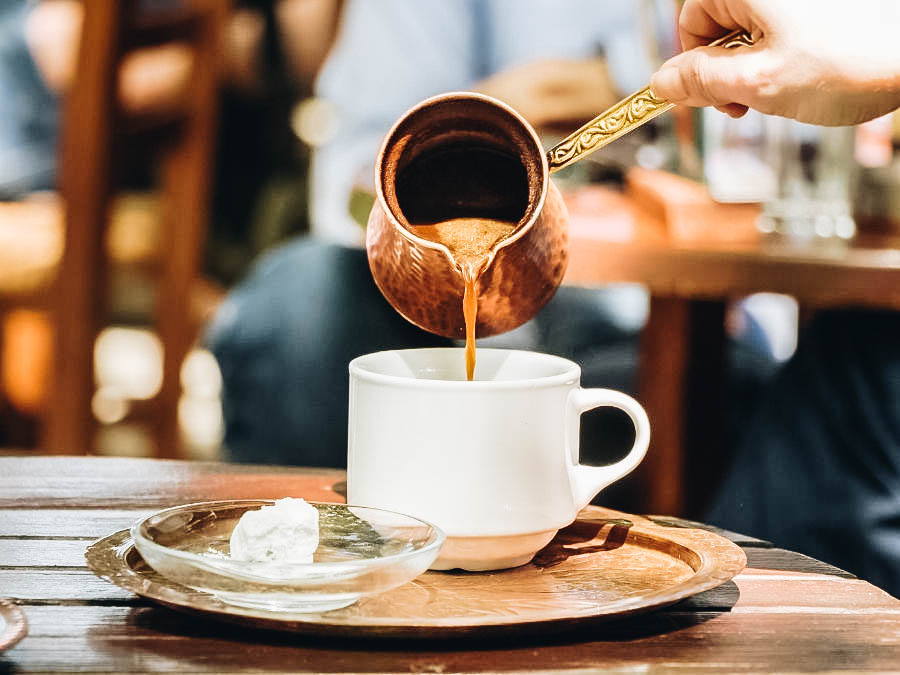 Greek Coffee being poured on a white cup