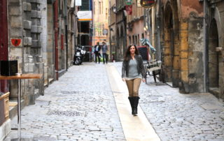 Annette White walking through the old town of Lyon, France