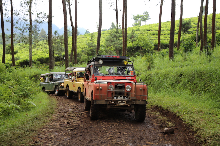 A caravan of Land Rovers while off-roading in Bandung, Indonesia
