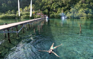 Annette White swimming at the Raja Ampat Dive Lodge