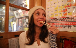 Annette White eating fresh fish at Tsuda-Sengyoten isakaya in Sendai Japan