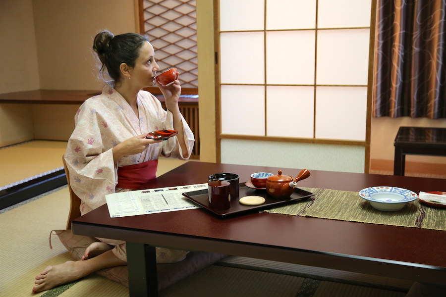 Annette White in a Kimono having tea in a traditional ryokan