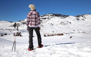 Annette White snowshoing through Yellowstone National Park