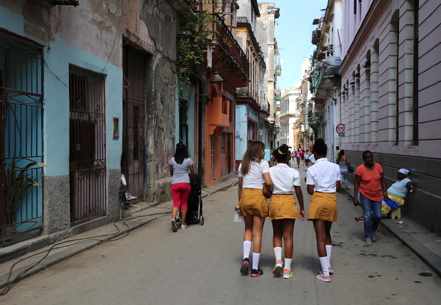 Young School girls walking home in Havana Cuba