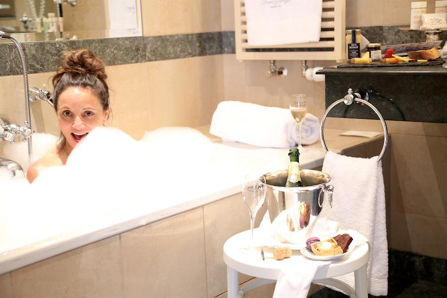 Annette White taking a tub soak at Beau Rivage Hotel in Geneva Switzerland