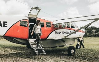 Annette white getting off the plane in Guyana