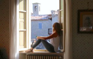 Annette White in the window of Palazzo Donati villa in Mercatello sul Metauro
