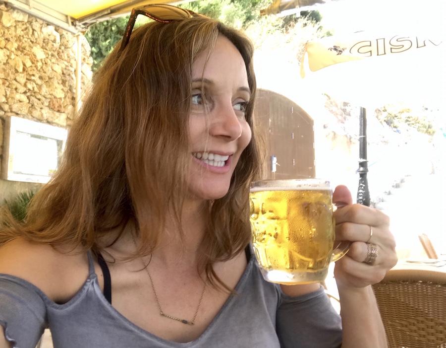 Annette White Drinking a Cisk beer in Malta