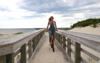 Annette White riding a bike in Cape Charles, Virginia