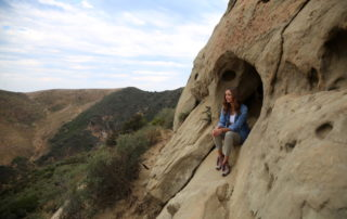 Annette White in a wind cave in Goleta, California