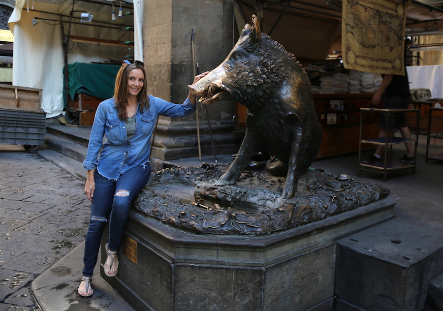 Florence Things to Do: Annette White rubbing the nose of Fontana del Porcellino