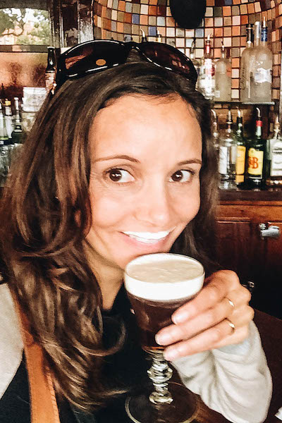 Annette White drinking Irish Coffee at The Buena Vista in San Francisco