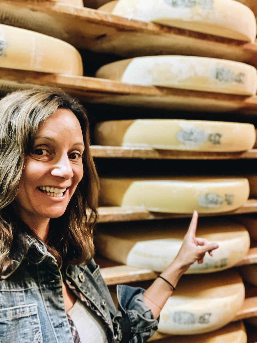 Selfie with Wheels of Comte Cheese