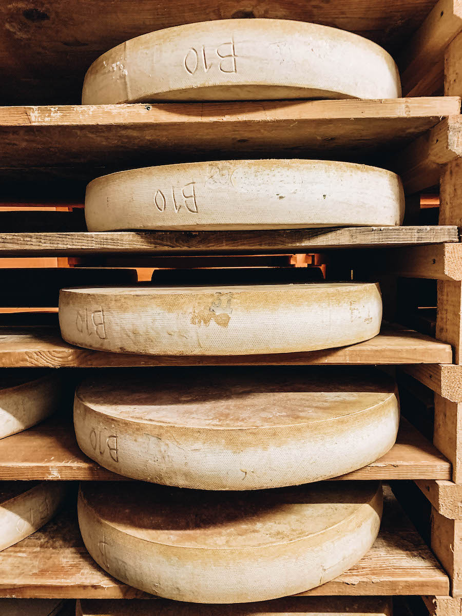 Wheels of Comte Cheese stacked and stored