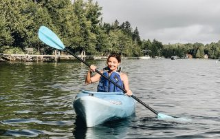 Annette White Kayaking in Rangeley maine