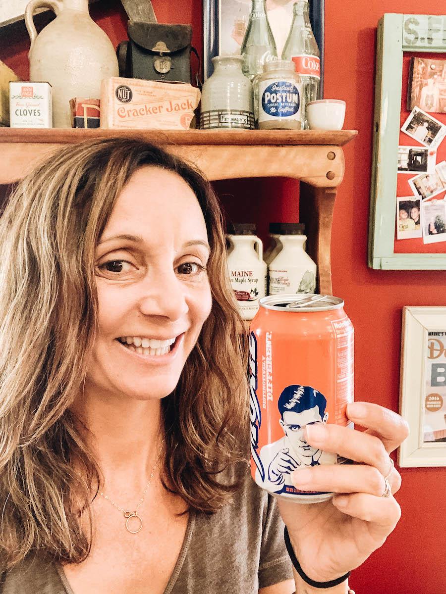 Annette White Drinking a Moxie in Damariscotta's Historic Main Street