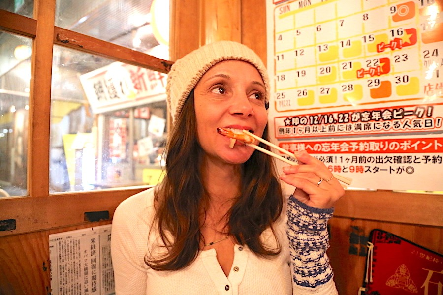 Annette White using chopsticks in Japan