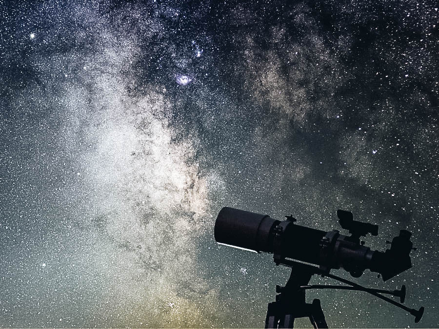A telescope set to view the starry sky and celestial bodies