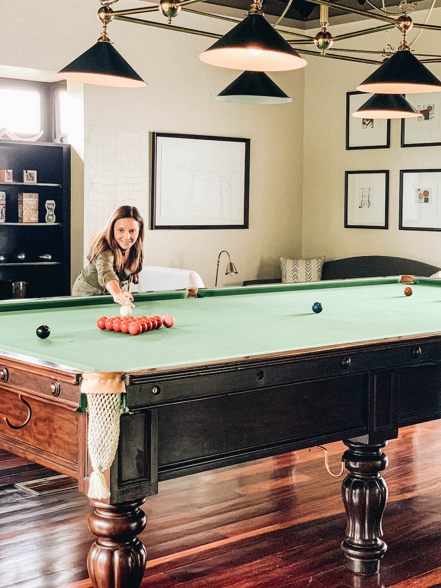 Annette playing billiards
