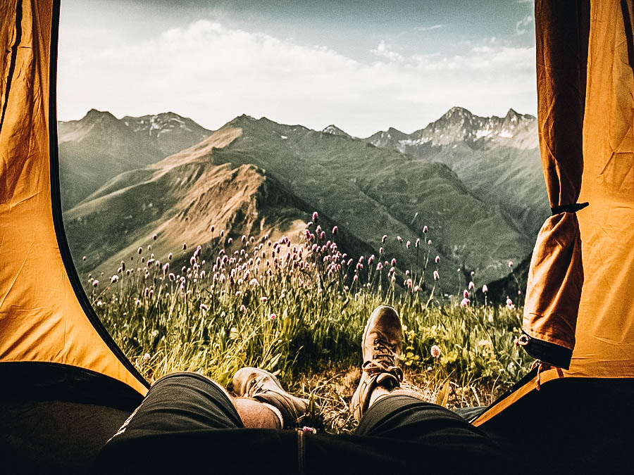 A man showing his view from his tent