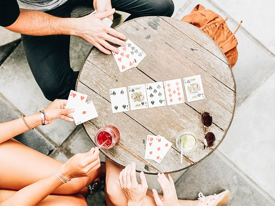 A group of friends playing card game