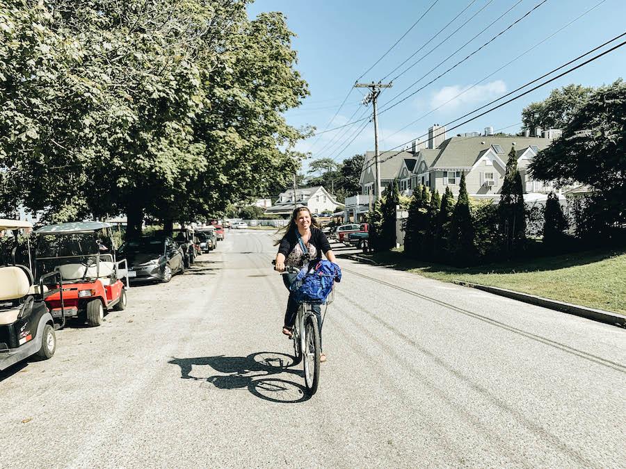 A girl exploring Peaks Island Maine by Bike