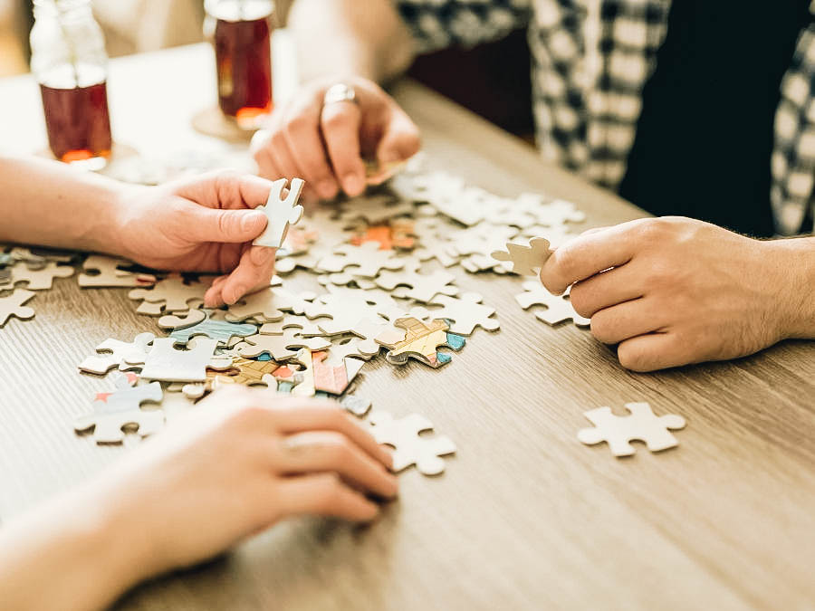 Two people playing jigsaw puzzles