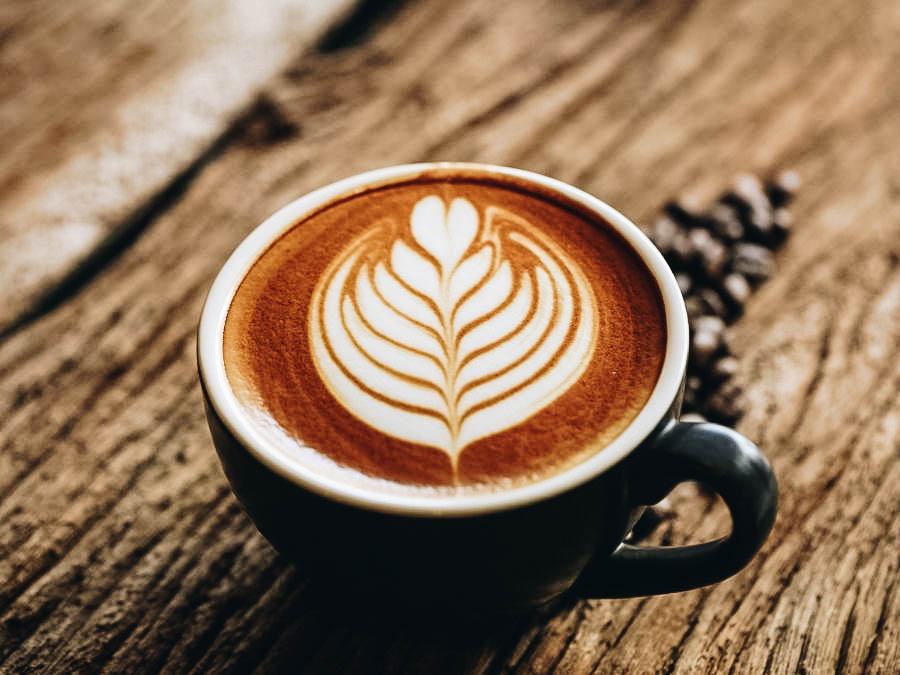 A black cup with latte art