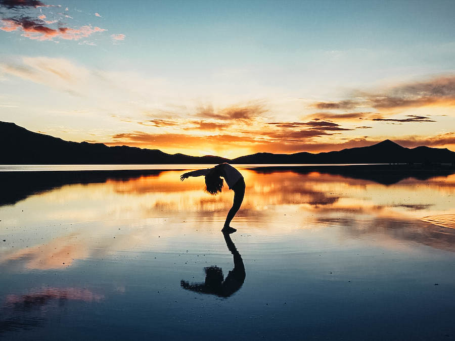 A yoga post on a sunset