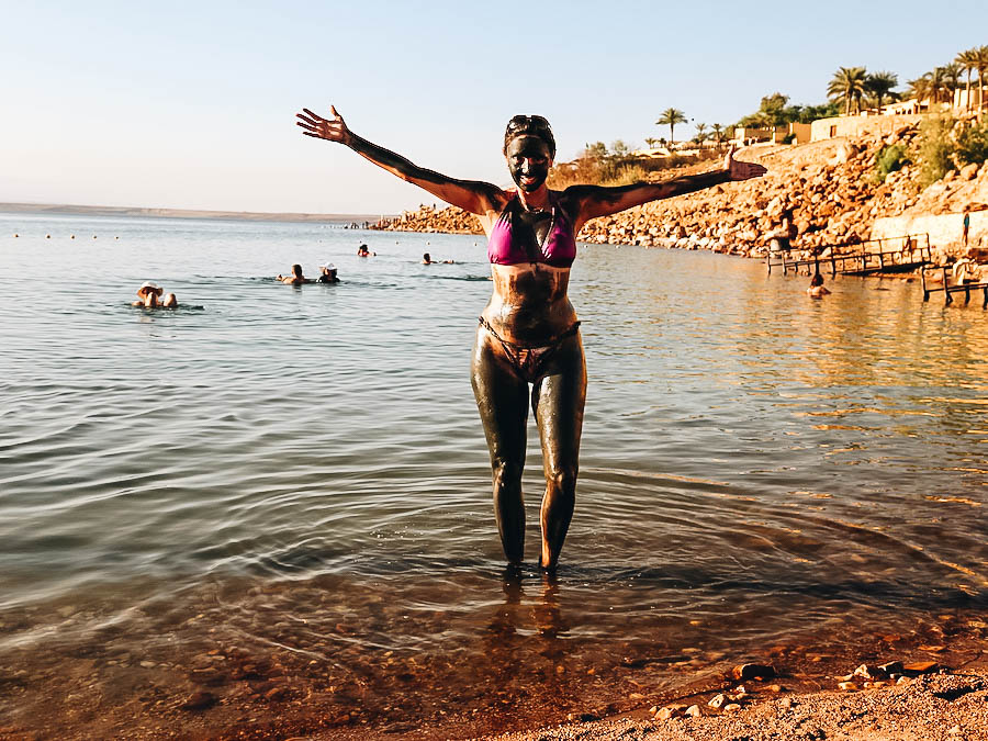 Annette wearing mud on her body before swimming to the Dead Sea.