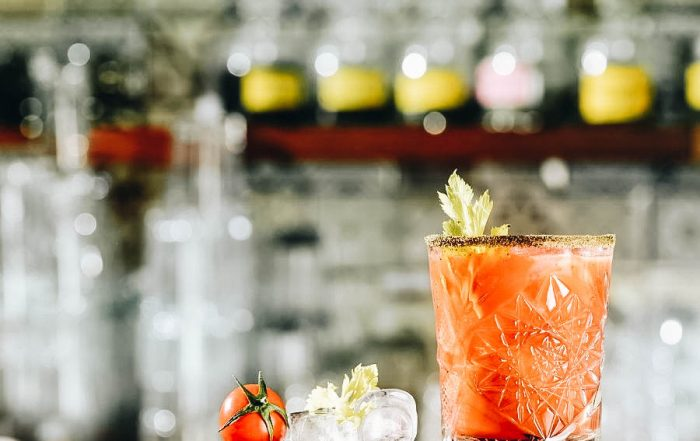 A glass of Bloody Mary Cocktail on a bar table