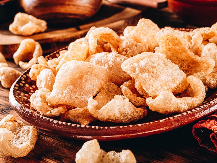 Crunchy chicharrones on a brown plate.