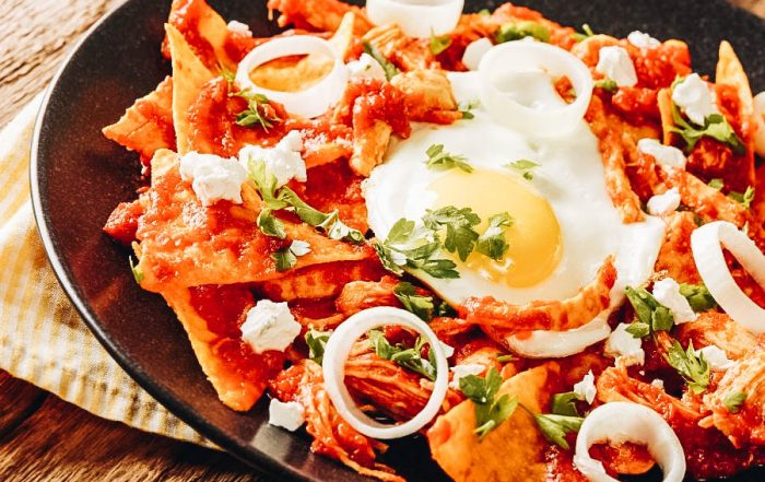 Chilaquiles topped with egg and onions