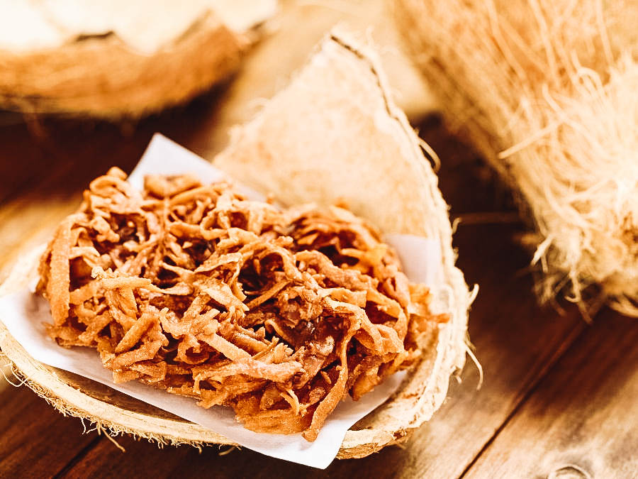 Delicious cocadas served on a coconut shell.