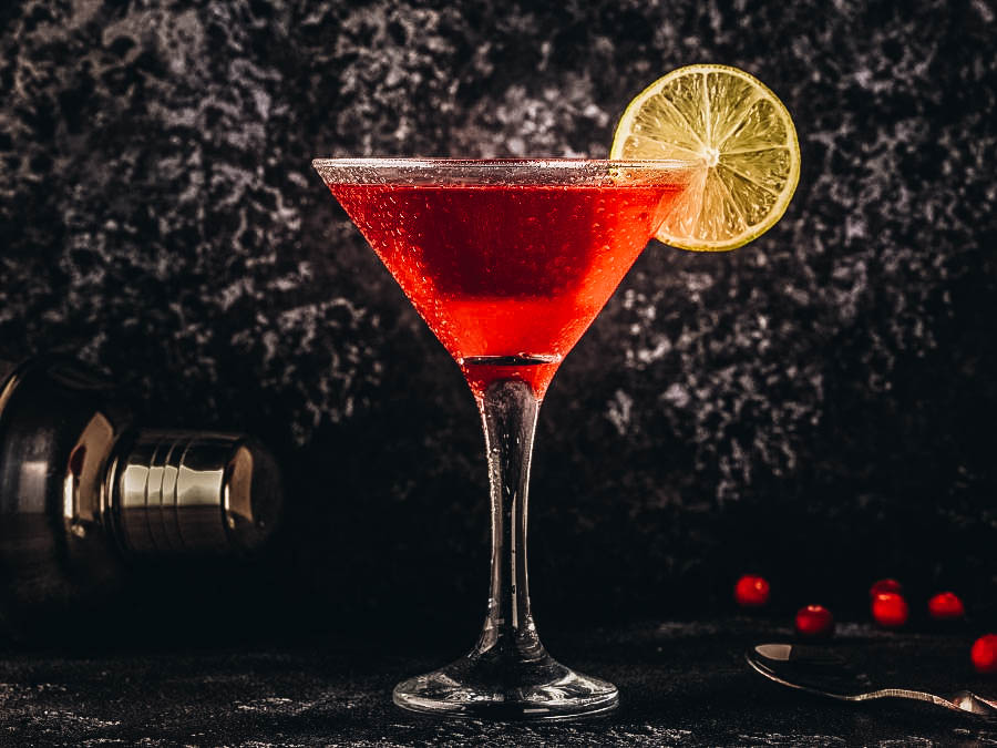 A Cosmopolitan Cocktail on a Dark background
