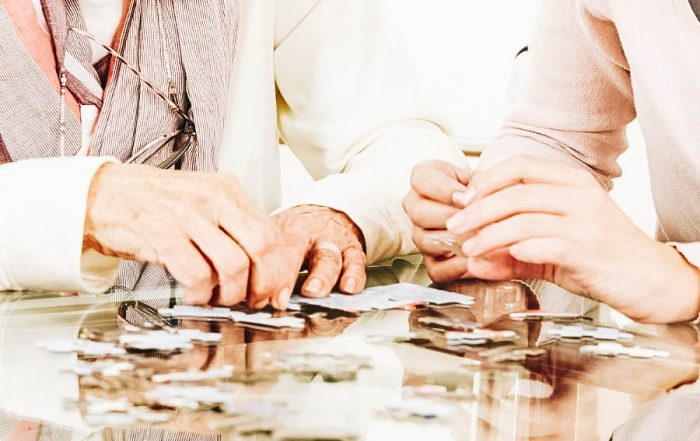 Two people enjoying a good set of jigsaw puzzles
