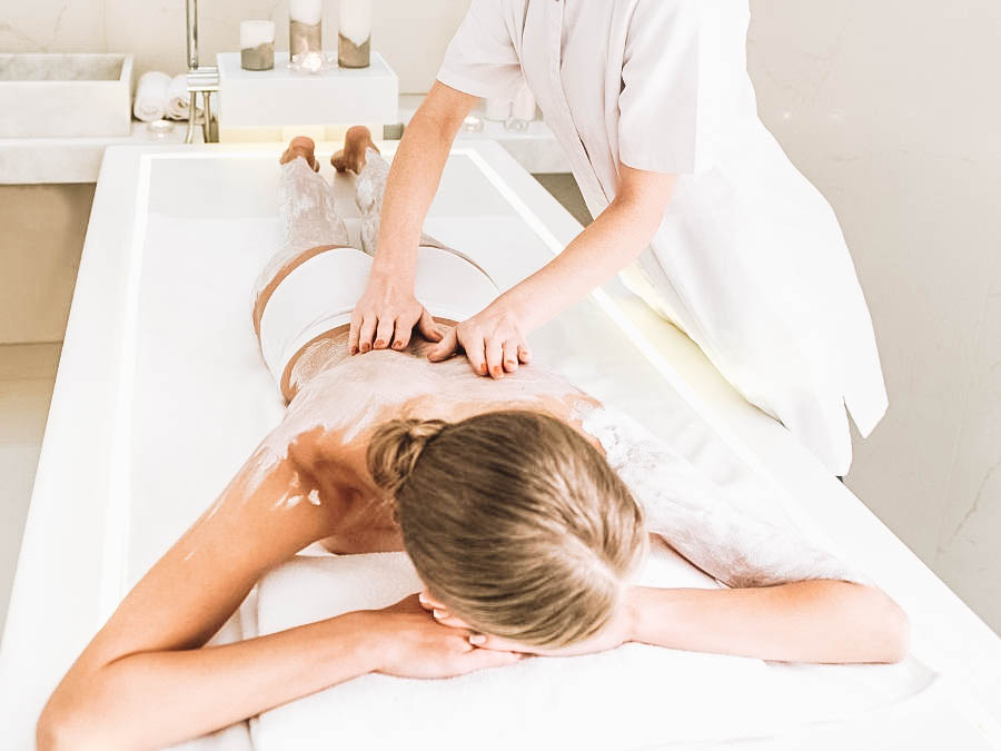 A person having a full body massage